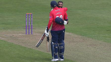 Varun Chopra of Essex is congratulated by Daniel Lawrence after reaching his century against Glamorg