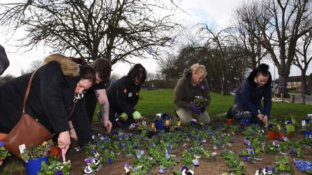 Local residents and staff from B&Q planting purple flowers in memory of murder victim Jodie Chesney