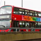 A number 25 bus passes by the Bow Flyover.