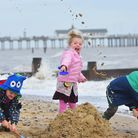 Youngsters enjoying the mild weather in December on Southwold Beach. Morgan Hopkins, Jessica Fairs a