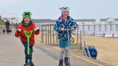 Youngsters enjoying the mild weather in December on Southwold Beach. Molly and Finn Rickards scootin