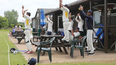 Rainham players applaud a half century from Jon O'Neill during the T-Rippon Mid-Essex League Premier