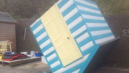 One of the beach huts, on the lower promenade in Lowestoft, that was tipped over. Picture: Supplied