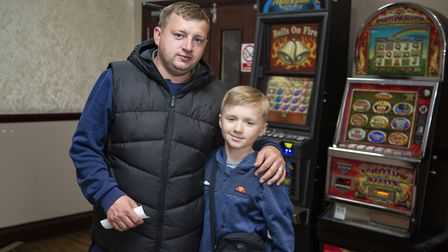 Bradley Batchelor and Teddy Batchelor, 11 enjoying the last day of the East Ham Working Men's club.