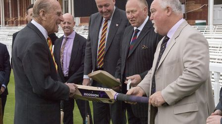The Duke of Edinburgh (left) is shown a number of bats by Mike Gatting (right) during a visit to Lor