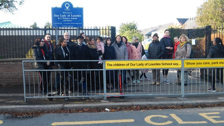 Parents protest outside Our Lady of Lourdes Primary, in Chestnut Drive, in October. Picture: Paul D