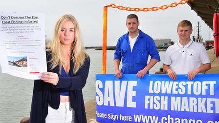 Scarlett Mummery has organised a petition to save Lowestoft Fish Market.Scarlett with William Master