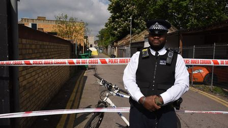 Police at the scene of the shooting at the Seven Kings Mosque.
