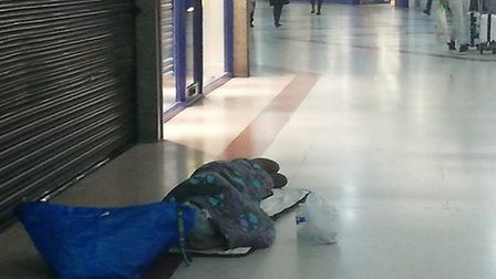 A rough sleeper on the floors of the Stratford Centre. Picture: Archant