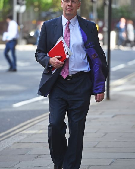 Chief coroner Judge Mark Lucraft QC arriving at the Old Bailey ahead of the inquests into the deaths