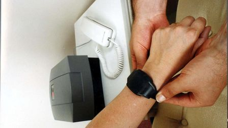 An electronic wrist tag. Picture: PA