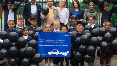 Pupils from North Beckton Primary School use balloons to learn about air pollution. Picture: Andrew