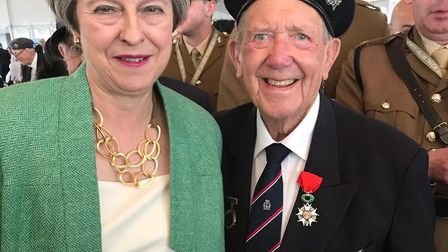 Ron Wilson from Upminster with prime minister Theresa May in Normandy. Picture: Wilson Family
