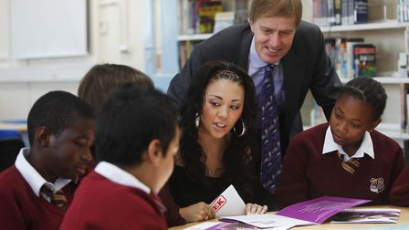 Stephen Timms with singer Mutya Buena during a visit to Langdon School. Picture: PA