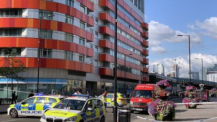 Police at the scene of the stabbing in Barking Road. Picture: Twitter/NewhamMPS