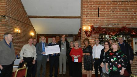 The Lowestoft Classic Vehicle Club presented Jeff Wood from the East Coast Hospice with a cheque for
