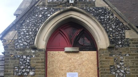The front entrance to St Matthew's Church in West Ham has been boarded up until the destroyed door i