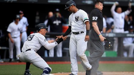 New York Yankees' Aaron Hicks (right) celebrates a run with team mate Aaron Judge during the MLB Lon