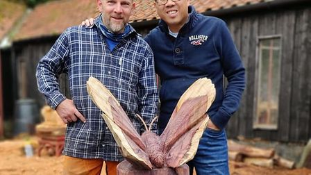 Scott with the sculptor Luke Chapman and the wooden butterly sculpture. Picture: Yang Lau