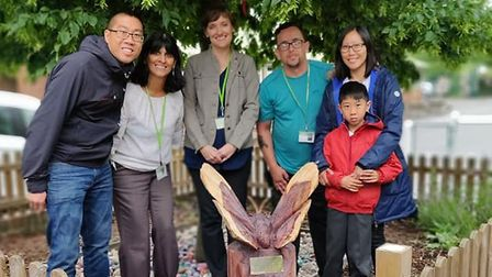 Scott (left) with Yang, Kaleigh's mum (far right) and her brother, Carson, with Ray Lodge Primary Sc