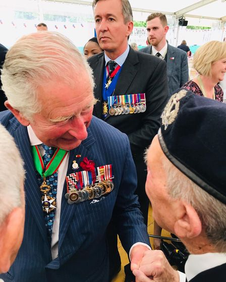 Ron meeting Prince Charles. Picture: Jennie Bardrick