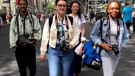 Chess Charles, centre, in New York during her trip to the US. Picture: Amber Terranova