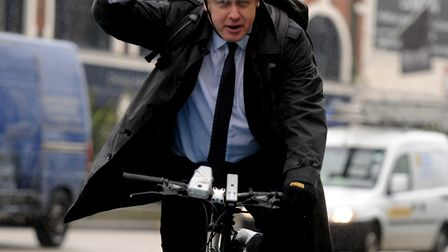 Boris Johnson arrives on a bike to the launch of the cycle super highway in Stratford. Picture: Davi
