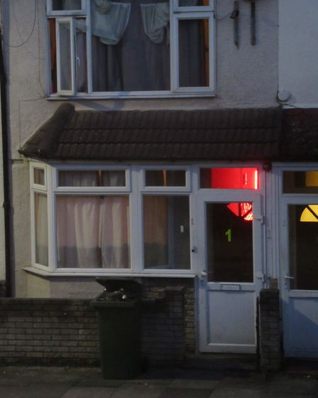 The house on June 28 with its red light on. People were seen entering the premises at around 9pm tha