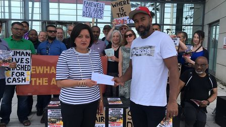Campaigner Kevin White hands Mayor Fiaz a letter to the RDEZ board from Newham Against the Arms Fair