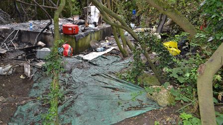 The men were living in this makeshift camp by the A406 at Ilford. Picture: Met Police