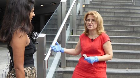 Dr Hermine Mkrtchyan taking samples from railings at at Straford station. Picture: UEL