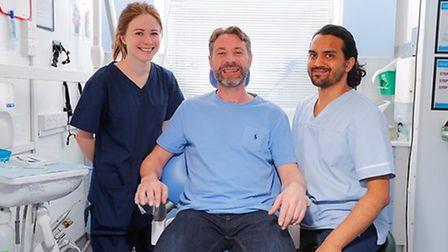 Dentist Isabel Margetts, patient Steve Cullen and special care dental nurse Abdul Hye. Picture: Kent