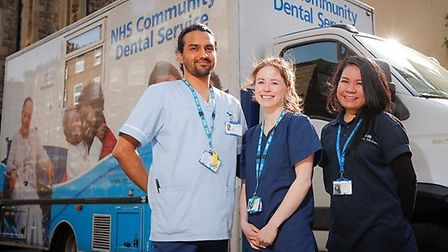 Special care dental nurse Abdul Hye, dentist Isabel Margetts and receptionist Nira Arteche outside t