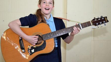 Katie Hitter, from year six, performs at Woods Loke Primary School. Pictures: MICK HOWES