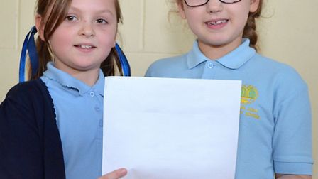 Honey Lee and Layla Swan, from year three, with their poem In Space they created with friend Shannon
