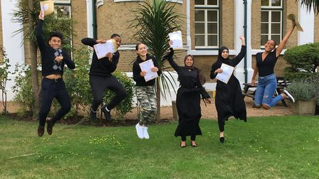 St Angela's Ursuline sixth formers celebrate after achieving top grades. Picture: Jon King