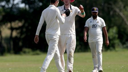 Rainham's Ben Little is congratulated by captain Jon O'Neill (right) after claiming a wicket (pic: G
