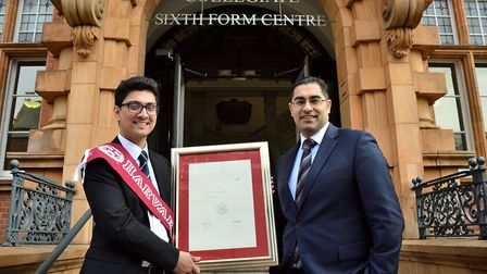 Mohammed Isuf Ahmed with Newham Collegiate principal Mouhssin Ismail. Picture: Mark Soanes