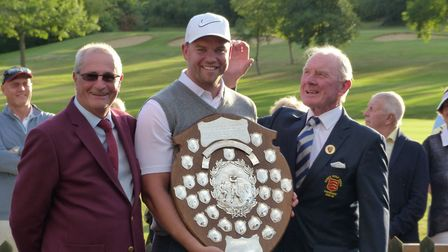 Upminster captain Alan Daly receives the Leslie F Wood silverware