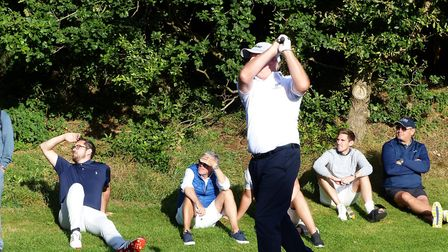 Upminster's Mick Nash plays his tee shot on the last before going on to win his match