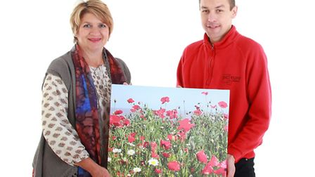 Jenny Bird, of Harrier Drive, Oulton Broad, collects her top prize - a 12in x 18in photo canvas, wor