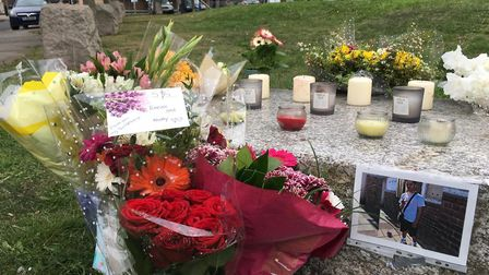 Tributes left to the 18-year-old stabbing victim, named locally as Santino, in Chadd Green, Plaistow