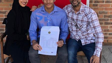 Jibriel Yahya and his proud father and sister celebrate his achieving seven grade 9s, two grade 8s a