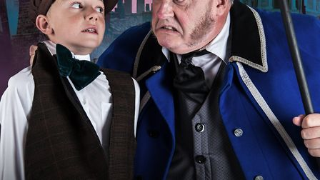 L-R: Billy Mears as Oliver and Stuart Crawley as Mr Bumble in Brookside Theatre's musical Oliver. Pi