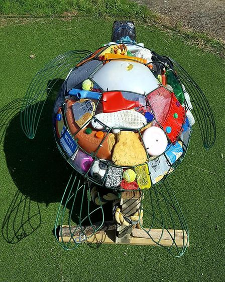 Welder Otis Griffith, from Rainham, has created a sea green turtle sculpture filled with rubbish fro
