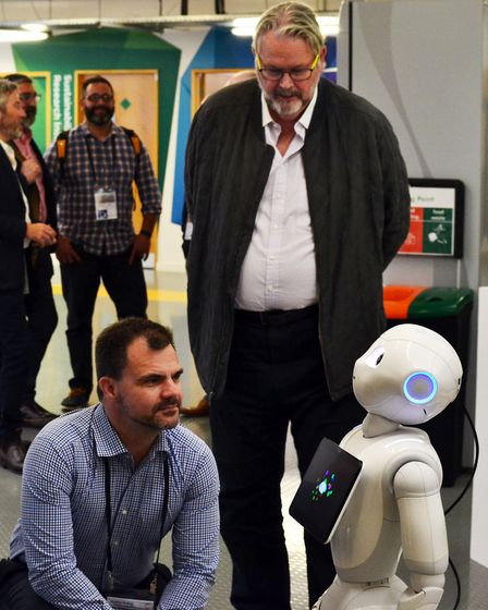 Delegates from the Western Sydney Leadership delegation meet Pepper, the University of East London's