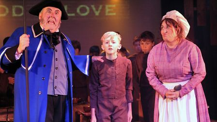 Stuart Crowley as Mr Bumble, Billy Mears as Oliver and Mrs Bumble in Brookside Theatre's Oliver! Pic