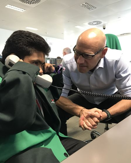Murad Farhat from Saint Francis Hospice's young adults group gets a lesson in how to make a trade an