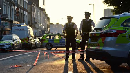 Police officers man a cordon in Finsbury Park, north London, after a van struck pedestrians outside