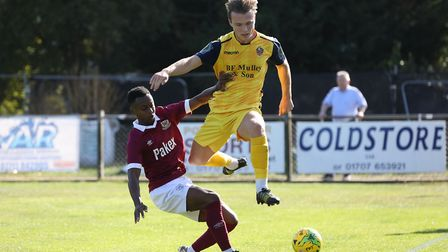 Ryan Young of Potters Bar Town tackles Mickey Parcell of Hornchurch during Potters Bar Town vs Hornc